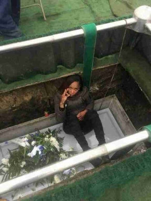 Madness!! See What Ugandan Slay Queen Was Caught Doing In Her Late Mother's Grave (Photos)
